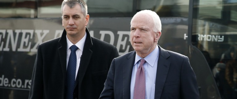 U.S. Senator McCain arrives on a visit at a migrant center near the village of Adasevci