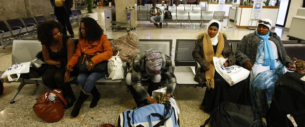 African immigrants wait to board their flight at the departure gates of Malta International Airport outside Valletta