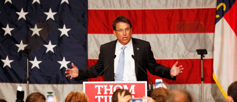 North Carolina Governor Pat McCrory talks to Republican candidate Thom Tillis' supporters during the U.S. midterm election rally for Tillis in Charlotte, North Carolina, November 4, 2014. REUTERS/Jason Miczek