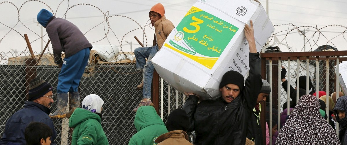 Syrian refugees receive aid packages at Al Zaatari refugee camp