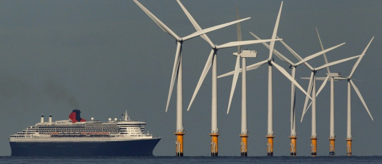 The cruise liner Queen Mary 2 passes the Burbo Bank off-shore wind farm as it heads to Liverpool, northern England September 15, 2011. The ship is visiting the city as part of the 2011 Mersey River Festival. REUTERS/Phil Noble