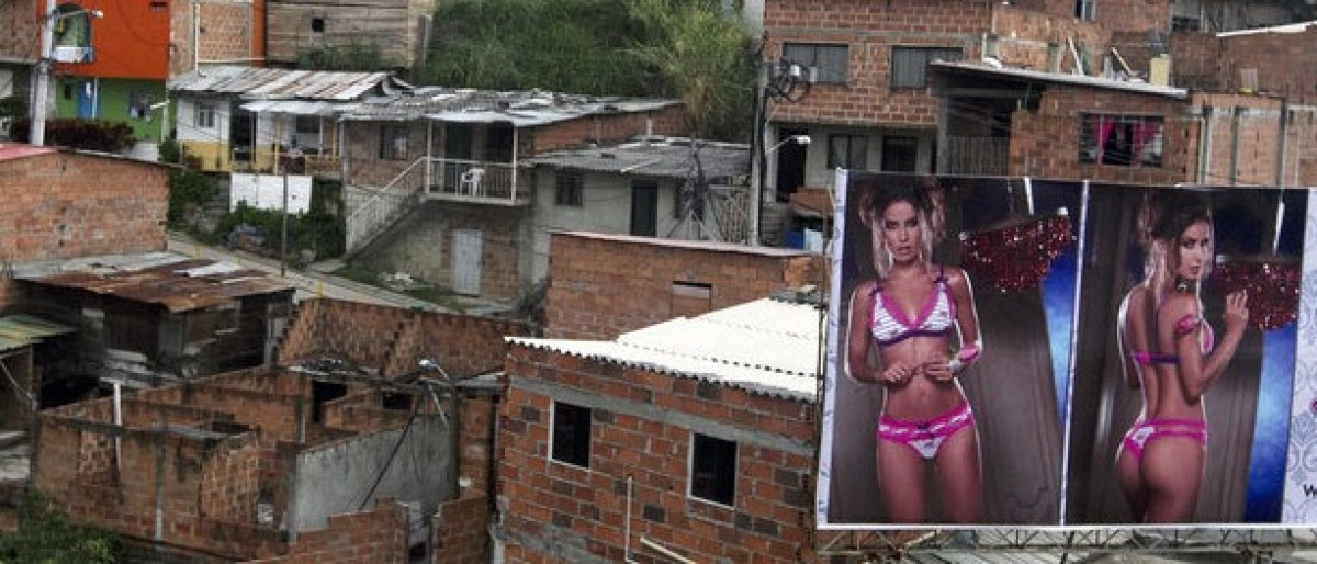 A billboard with pictures of a lingerie model is seen in front of the Commune northwest of Medellin city March 12, 2013. REUTERS/Albeiro Lopera