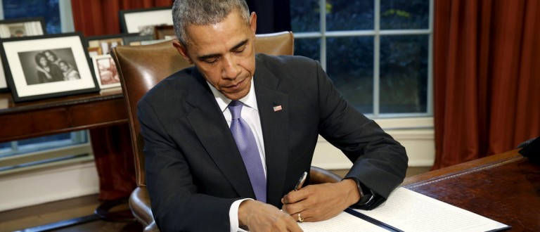 """U.S. President Barack Obama vetoes H.R. 1735 """"National Defense Authorization Act for Fiscal Year 2016"""" in the Oval Office of the White House in Washington October 22, 2015. Obama officially vetoed the $612 billion defense bill on Thursday, sending the legislation back to Congress because of the way it uses money meant for war spending to avoid automatic budget cuts to military programs. REUTERS/Kevin Lamarque"""