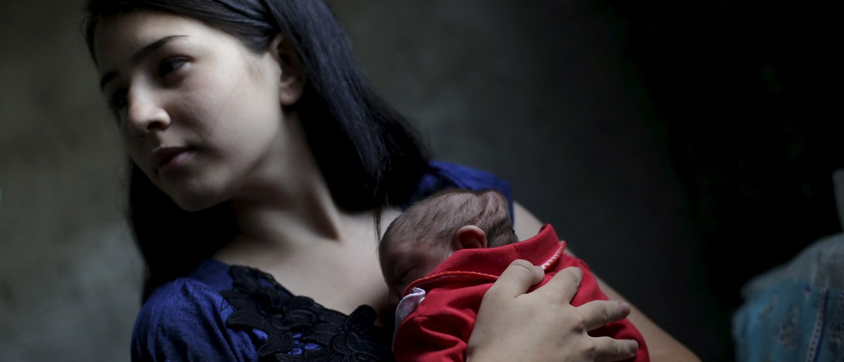 Ianka Mikaelle Barbosa, 18, poses for a photograph with Sophia, 18 days old, who is her second child and was born with microcephaly, at her house in Campina Grande, Brazil February 17, 2016. Single parents are common in Brazil where some studies show as many as one in three children from poor families grow up without a biological father, but doctors on the frontline of the Zika outbreak say they are concerned about how many mothers of babies with microcephaly are being abandoned. With the health service already under strain, abortion prohibited, and the virus hitting the poorest hardest, an absent father is yet another burden on mothers already struggling to cope with raising a child that might never walk or talk. REUTERS/Ricardo Moraes