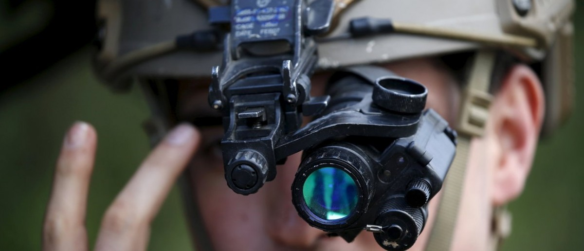 A U.S. Air Force Forward air controller adjusts his night vision goggles during the close air support (CAS) exercise Serpentex 2016 hosted by France in the Mediterranean island of Corsica, March 15, 2016. Serpentex is an annual exercise that involves joint terminal attack controllers (JTACs) from 12 countries from March 7 to March 25, 2016. REUTERS/Charles Platiau
