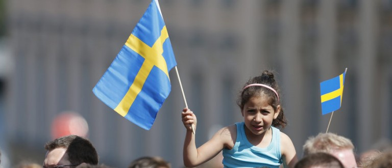 A girl waves Swedish flags outside the royal church where the wedding ceremony of Sweden's Princess Madeleine and her U.S.-British banker fiance Christopher O'Neill will take place, at the royal castle in Stockholm June 8, 2013. Princess Madeleine, 30, daughter of Sweden's King Carl XVI Gustaf and Queen Silvia, marries U.S.-British banker O'Neill, 38, on Saturday at a wedding to be attended by European royals and socialites from across the Atlantic. REUTERS/Bertil Enevag Ericson/Scanpix