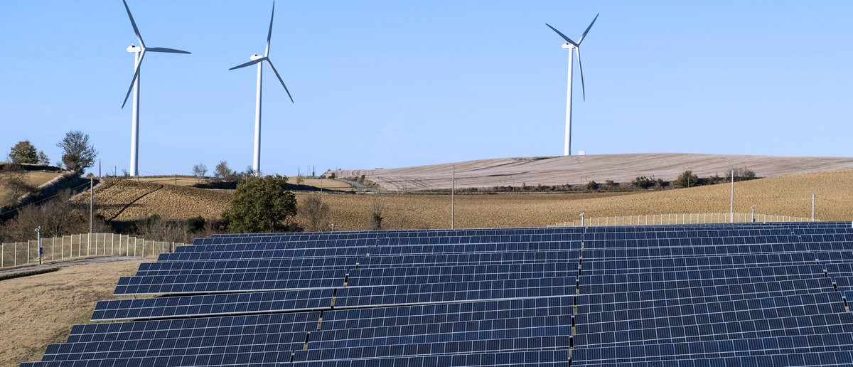 General view shows wind turbines behind rows of solar panels in Avignonet-Lauragais, in the Midi-Pyrenees region, France, October 30, 2015. The mixed site produces electricity from a wind farm of twelve turbines and 20,320 solar panels. France is host to the COP21, the World Climate Summit from November 30 to December 11, 2015. Picture taken October 30, 2015. REUTERS/Fred Lancelot