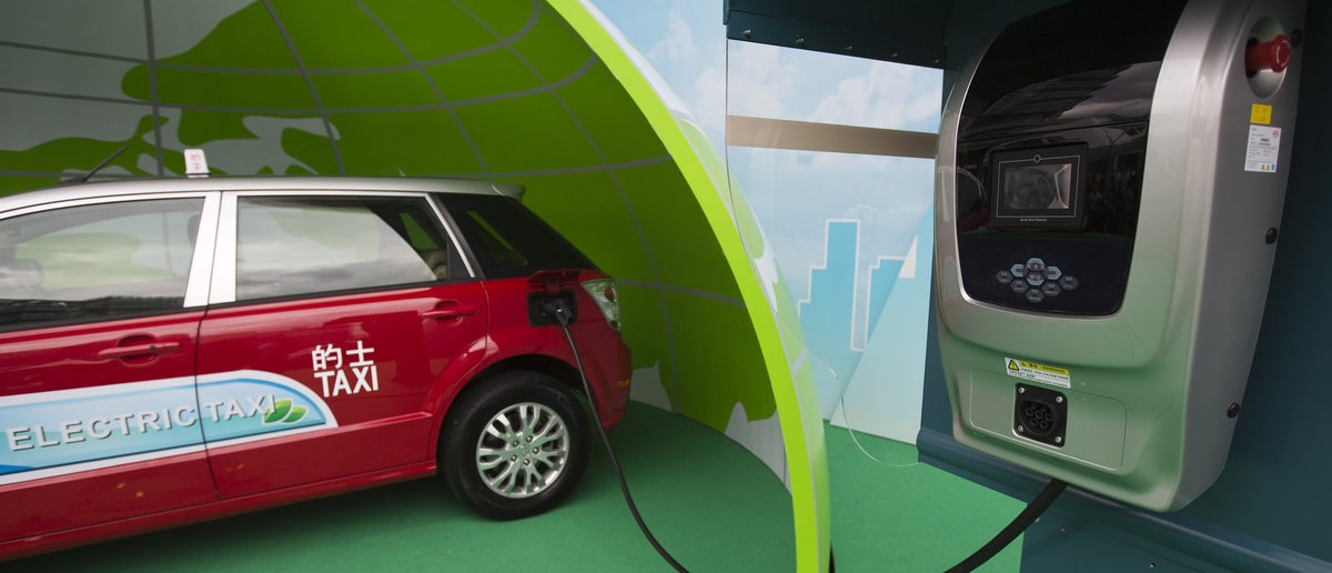 A BYD E6 electric car, which will be used as a taxi, is seen plugged into a charging unit during a launch ceremony for the line vehicles in Hong Kong, May 15, 2013. Forty-five of BYD's e6 Electric Cars will follow in the footsteps of Shenzhen and progressively join the fleet of taxis on Hong Kong's roads starting this month, the company said on Wednesday. REUTERS/Tyrone Siu