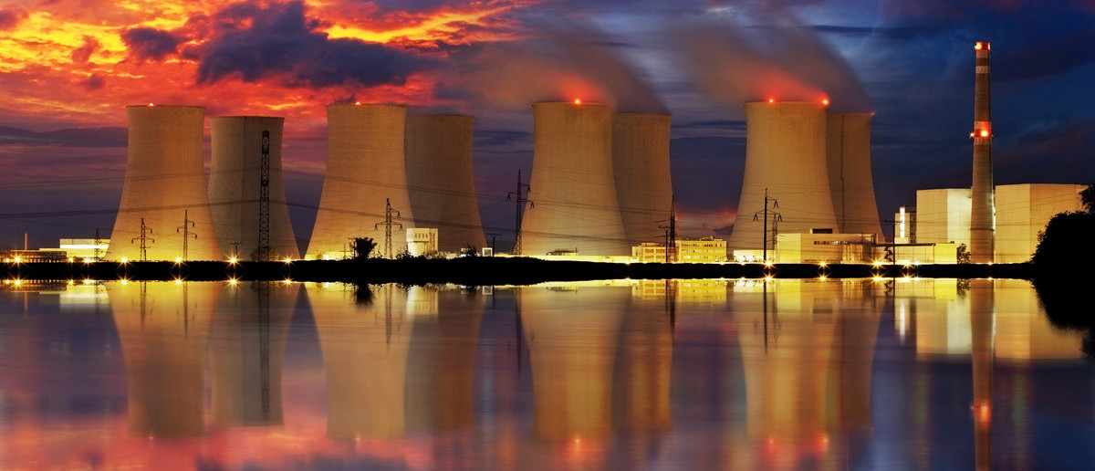 Nuclear power plant by night.(Shutterstock.com/TTstudi)