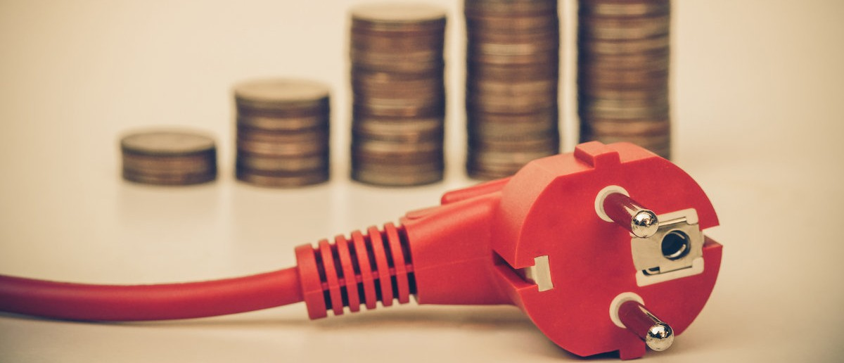 Photo of money and a power cord  Shutterstock / wk1003mike