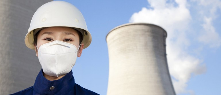 Worker with hardhat and mask at nuclear power plant. (Shuttershock)