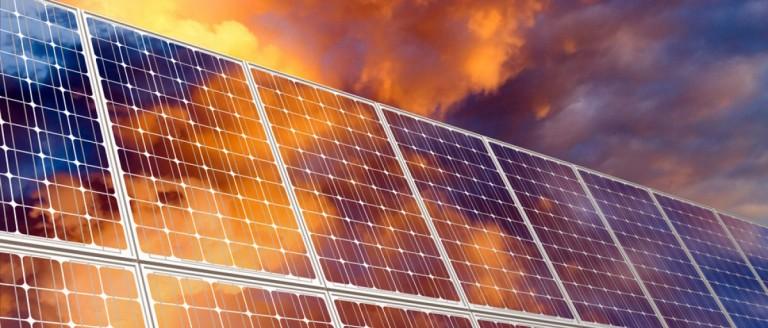 Solar panels at sunset. (Fedorov Oleksiy/Shuttershock)