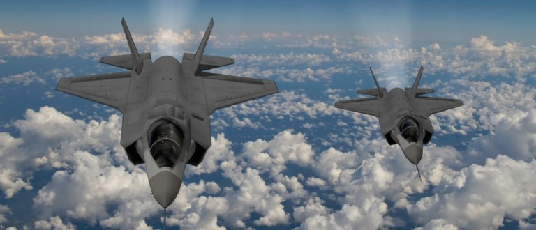 Two F-35s fly side-by-side. Source: Keith Tarrier/Shutterstock
