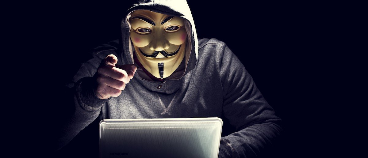 Portrait of a hacker in a mask. (Shutterstock/Gualtiero Boffi)