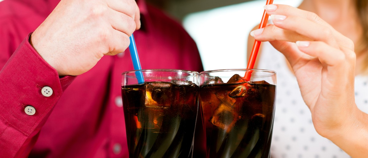 Couple drinking soda in a bar or restaurant (Credit: Kzenon/Shutterstock)