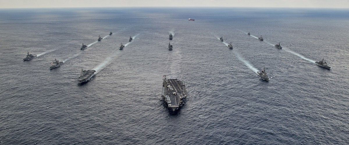 U.S. Navy and Japan Maritime Self-Defense Force ships steam in formation during their military manoeuvre exercise known as Keen Sword 15 in the sea south of Japan, in this November 19, 2014 handout provided by the U.S. Navy. Japan stepped up its role in large-scale war games with the U.S. this week, with one of its admirals commanding air and sea manoeuvres that the U.S. military described as the most complex ever overseen by the Japanese navy. The Keen Sword exercises involving more than 30,000 Japanese troops and 11,000 U.S. personnel come as Japanese Prime Minister Shinzo Abe seeks a higher profile for Japan in the security alliance. Picture taken November 19, 2014. REUTERS/Mass Communication Specialist 3rd Class Chris Cavagnaro/U.S. Navy/Handout via Reuters.