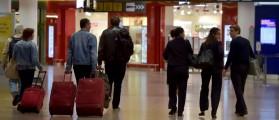 Members of staff and travelers walk in the airport REUTERS/Eric Vidal)