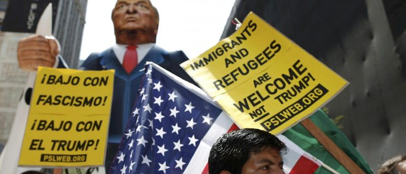 People march with an inflatable effigy of Republican presidential candidate Donald Trump during an immigrant rights May Day rally in Los Angeles