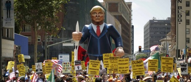 People march with an inflatable effigy of Republican presidential candidate Donald Trump during an immigrant rights May Day rally in Los Angeles, California, U.S., May 1, 2016. REUTERS/Lucy Nicholson