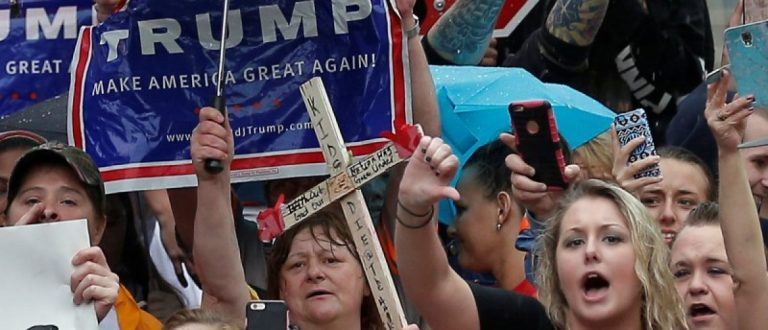 Supporters of U.S. Republican presidential candidate Donald Trump protest outside a campaign event for Democratic presidential candidate Hillary Clinton in Williamson, West Virginia, United States, May 2, 2016. REUTERS/Jim Young