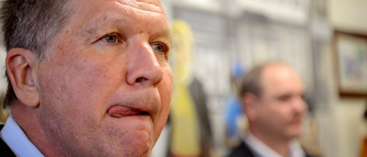 U.S. Republican presidential candidate and Ohio Governor John Kasich licks his lips in an ice cream shop in Catonsville