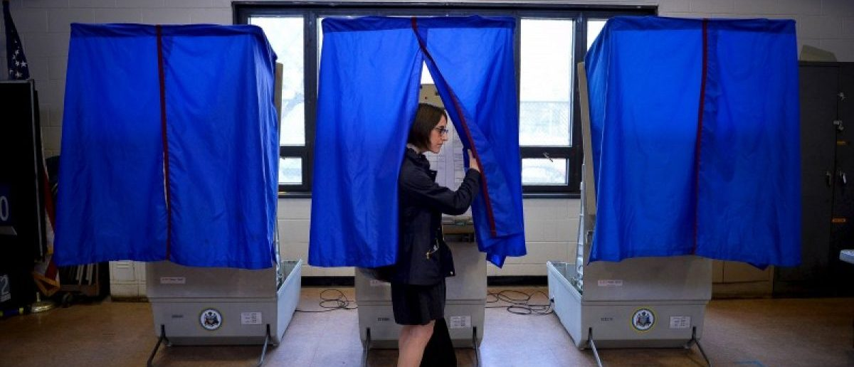 A voter leaves the booth after casting her ballot in the Pennsylvania primary at a polling place in Philadelphia, Pennsylvania, U.S., April 26, 2016. REUTERS/Charles Mostoller