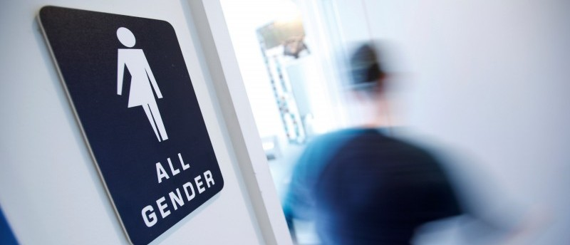 A bathroom sign welcomes both genders at the Cacao Cinnamon coffee shop in Durham, North Carolina