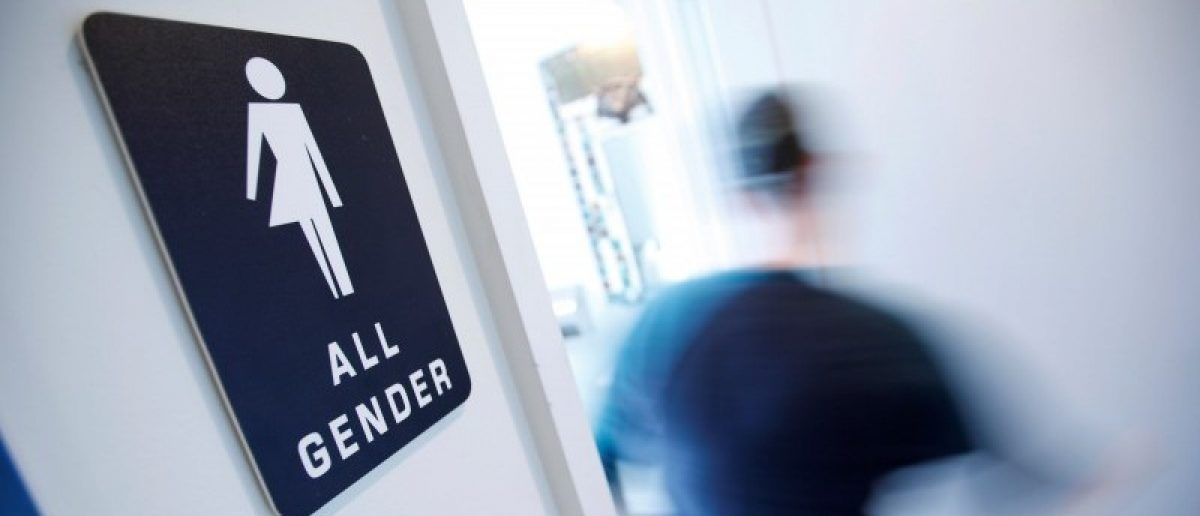 A bathroom sign welcomes both genders at the Cacao Cinnamon coffee shop in Durham, North Carolina May 3, 2016. REUTERS/Jonathan Drake