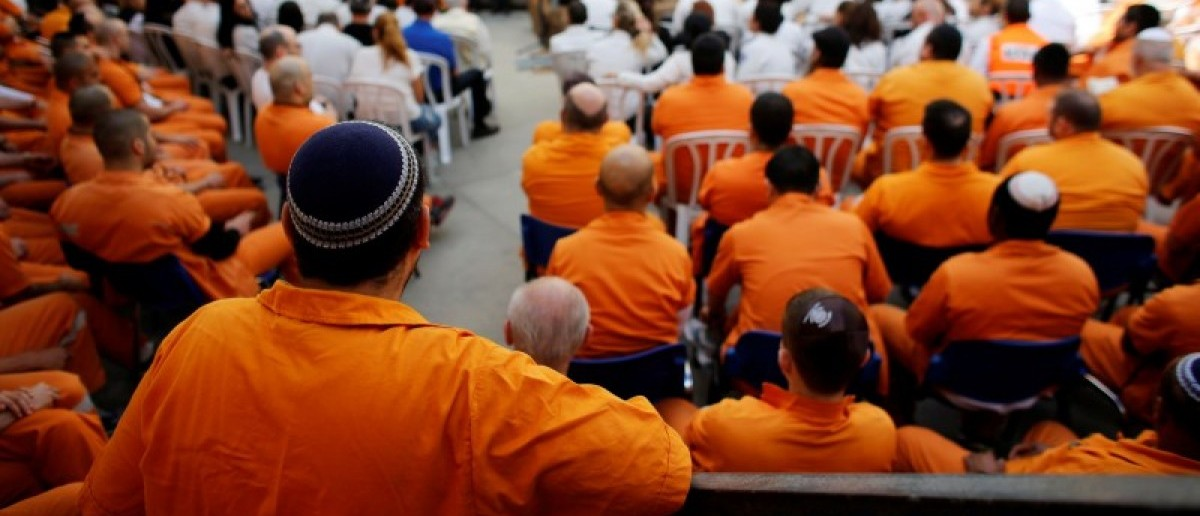 Prisoners take part in a ceremony marking the annual Holocaust Remembrance Day in Israel at Rimonim Prison, central Israel May 5, 2016. REUTERS/Nir Elias