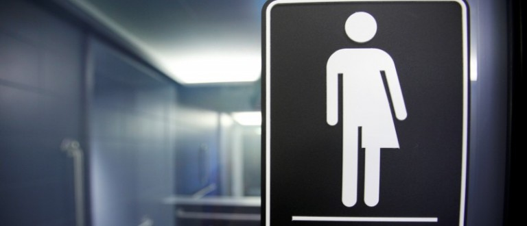A sign protesting a recent North Carolina law restricting transgender bathroom access adorns one of the stalls at the 21C Museum Hotel in Durham, North Carolina
