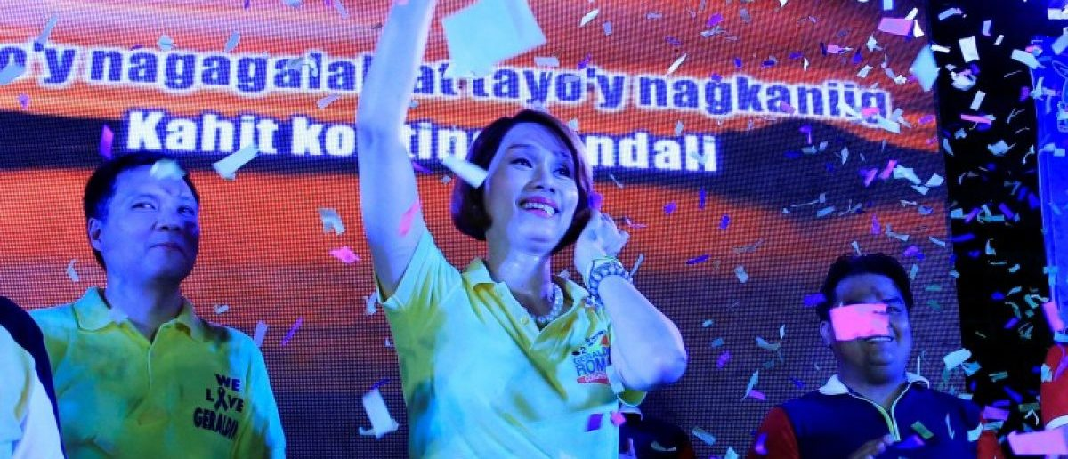 "Geraldine Roman, a transgender congressional candidate, waves to her supporters, as confetti rains during a ""Miting de Avance"" (last political campaign rally) for the national election in Orani town, Bataan province, north of Manila in the Philippines May 6, 2016. REUTERS/Romeo Ranoco"