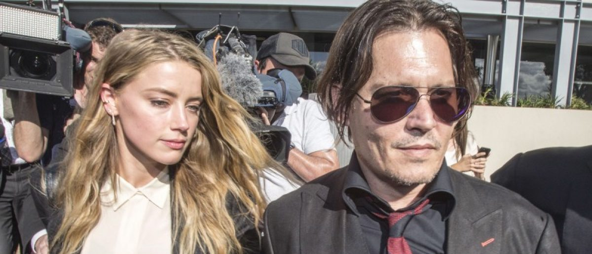 Actor Johnny Depp and wife Amber Heard arrive at the Southport Magistrates Court on Australia's Gold Coast. Amber Heard appeared in the Queensland court Monday charged with illegally smuggling the couple's Yorkshire terriers, Pistol and Boo, into the country on a private jet while Depp was shooting a Pirates of the Caribbean movie last year. REUTERS/Dave Hunt/AAP