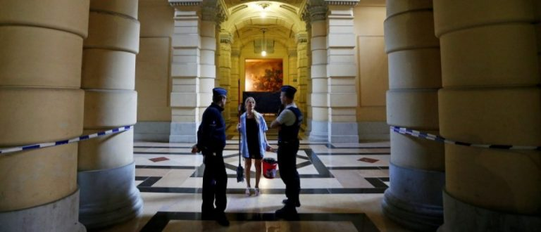 Belgian police officers stand guard at the entrance of the courtroom of the trial of suspects in foiled Islamist attack plot in the town of Verviers last year, at the Brussels Palace of Justice, Belgium, May 9, 2016. REUTERS/Francois Lenoir