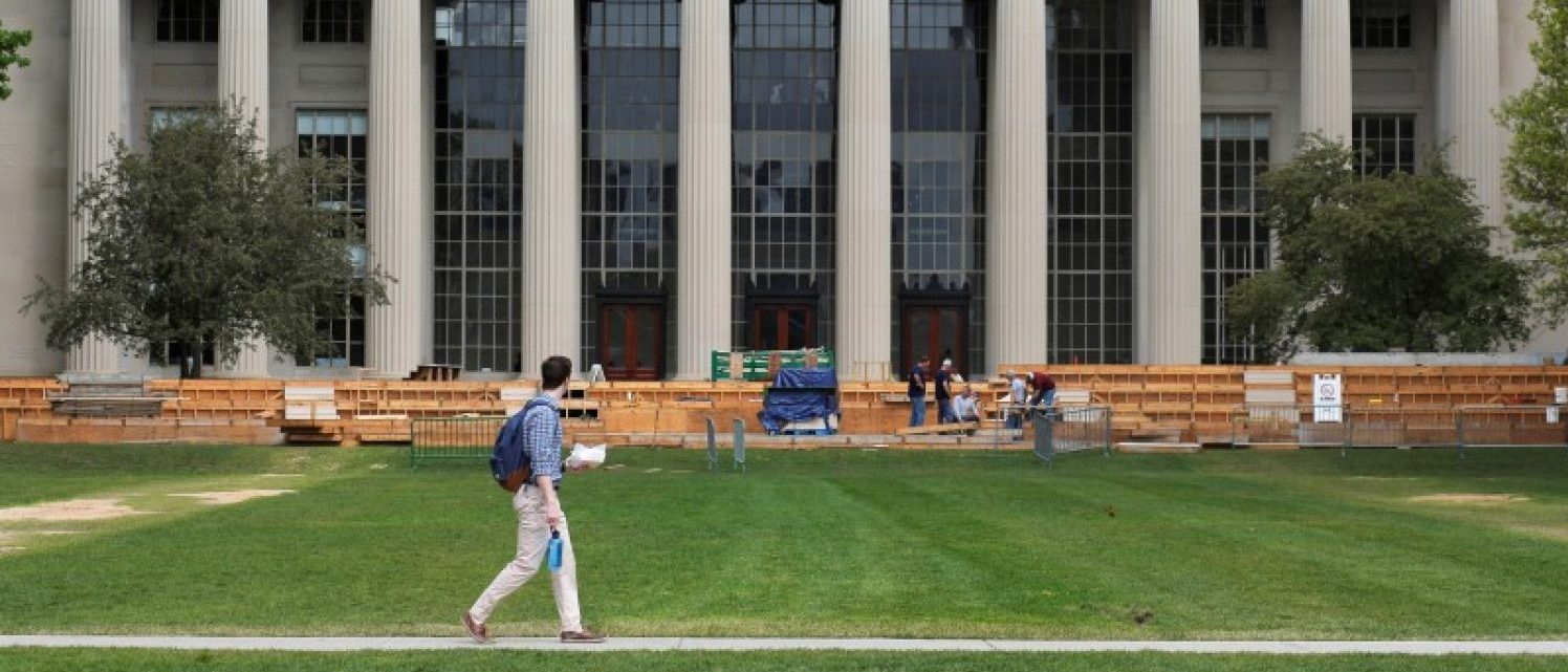 A man walks through Killian Court at the Massachusetts Institute of Technology (MIT) in Cambridge, Massachusetts, U.S., May 13, 2016.  REUTERS/Brian Snyder