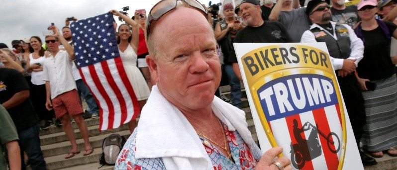 A man carries a sign for Republican U.S. presidential candidate Donald Trump at the Rolling Thunder motorcycle rally to highlight POW-MIA issues on Memorial Day weekend in Washington, U.S. May 29, 2016.  REUTERS/Jonathan Ernst