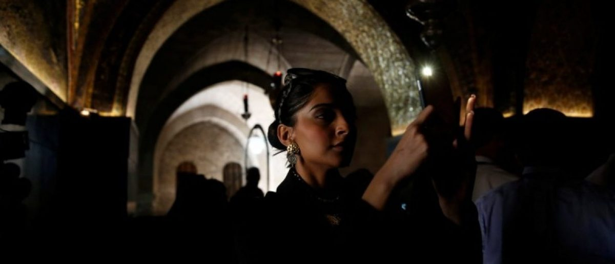 Sonam Kapoor takes a photograph during her visit to the Church of the Holy Sepulchre in Jerusalem's Old City May 30, 2016 REUTERS/Ammar Awad