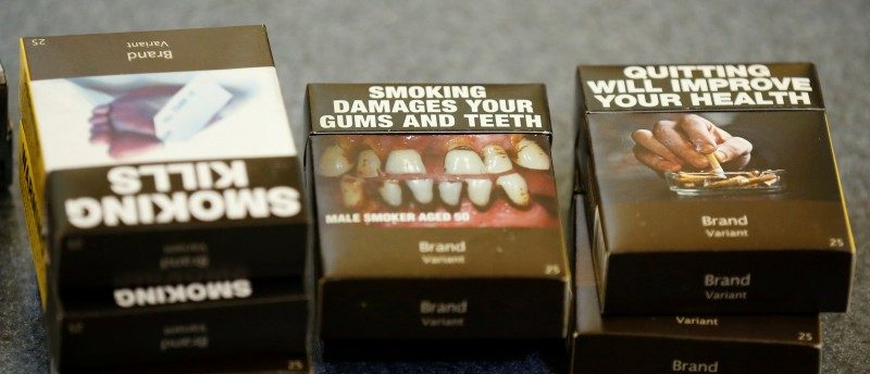 Mock-ups of plain cigarette packaging are seen before the start of a news conference in Ottawa, Ontario, Canada, May 31, 2016. REUTERS/Chris Wattie
