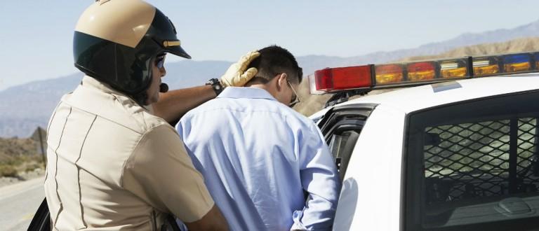 Cop arrests man, bikeriderlondon, Shutterstock