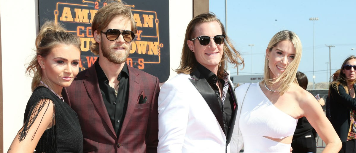 INGLEWOOD, CA - MAY 01: Singers Brian Kelley (2nd L) and Tyler Hubbard (2nd R) of Florida Georgia Line with Brittney Marie Cole (L) and Hayley Stommel (R) attend the 2016 American Country Countdown Awards at The Forum on May 1, 2016 in Inglewood, California. (Photo by Frederick M. Brown/Getty Images)