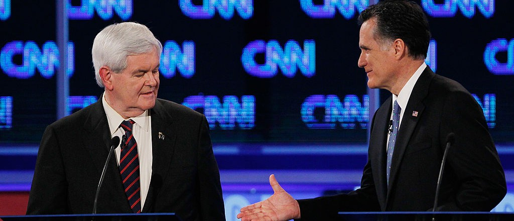 JACKSONVILLE, FL - JANUARY 26:  Republican presidential candidates, former Speaker of the House Newt Gingrich (R-GA) and former Massachusetts Gov. Mitt Romney shake hands at the end of a debate sponsored by CNN, the Republican Party of Florida and the Hispanic Leadership Network at the University North Florida on January 26, 2012 in Jacksonville, Florida. The debate is the last one before the Florida primaries January 31st.  (Photo by Joe Raedle/Getty Images)