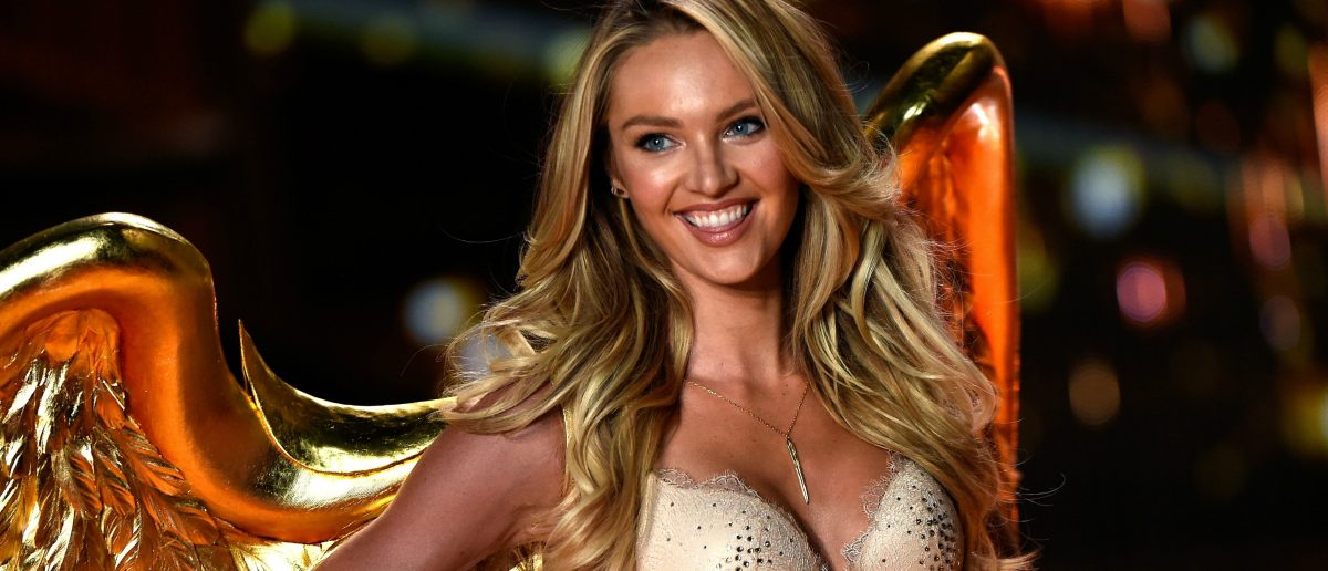 Model Candice Swanepoel walks the runway at the annual Victoria's Secret fashion show at Earls Court on December 2, 2014 in London