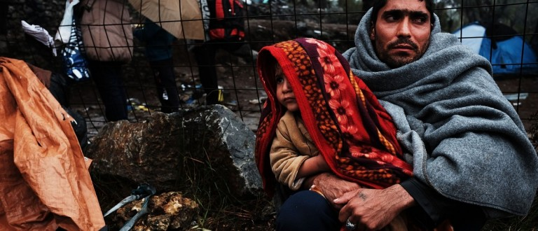 A man holds his child at the increasingly overwhelmed Moria camp on the island of Lesbos on October 23, 2015 in Mitilini, Greece. (Spencer Platt/Getty Images)