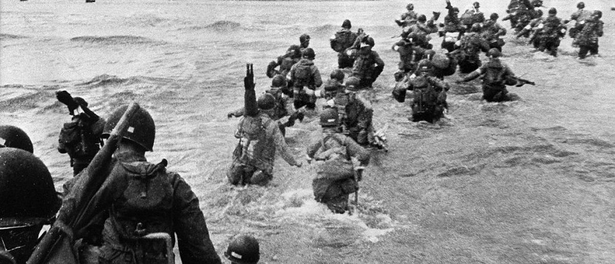UTAH BEACH, FRANCE: US troops disembark from landing crafts during D-Day 06 June 1944 after Allied forces stormed the Normandy beaches. D-Day, 06 June 1944 is still one of the world's most gut-wrenching and consequential battles, as the Allied landing in Normandy led to the liberation of France which marked the turning point in the Western theater of World War II. AFP PHOTO (Photo credit should read -/AFP/Getty Images)