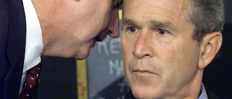This Sept. 11, 2001 file photo from an early morning school reading event Sarasota, Florida, shows White house chief of staff Andrew Card informing President George W. Bush of the attacks on the World Trade Center in New York