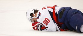 Marcus Johansson of the Washington Capitals lays injured on the ice in the first period against the Pittsburgh Penguins in Game Three of the Eastern Conference Second Round during the 2016 NHL Stanley Cup Playoffs at Consol Energy Center on May 2, 2016 in Pittsburgh