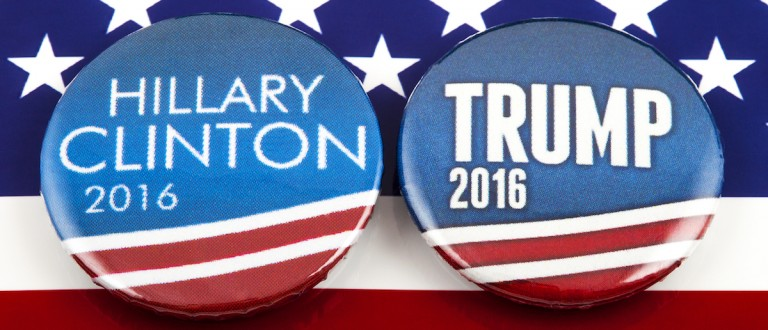 Hillary Clinton and Donald Trump pin badges over the American flag, symbolizing their battle to become the next President of the United States, 3rd March 2016.
