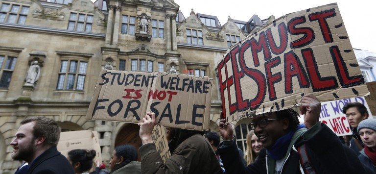 Students protest under the statue of Cecil Rhodes outside Oriel College in Oxford University, March 9, 2016