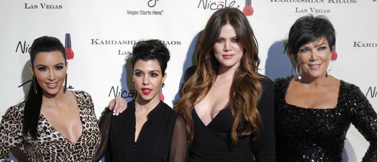 Kim Kardashian, Kourtney Kardashian, Khloe Kardashian and Kris Jenner arrive at the grand opening of the Kardashian Khaos store at the Mirage Hotel and Casino in Las Vegas