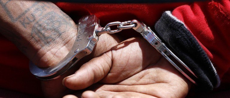 The handcuffs of a suspect (REUTERS/Jonathan Alcorn)