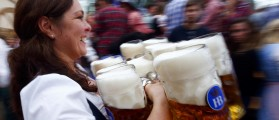 A waitress carries beer during the first day of the 182nd Oktoberfest in Munich, Germany, September 19, 2015. Millions of beer drinkers from around the world will come to the Bavarian capital over the next two weeks for Oktoberfest, which starts today and runs until October 4, 2015.      REUTERS/Michael Dalder
